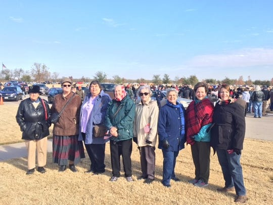 Members of the John Davis Chapter of the National Daughters of the American Revolution braved the cold to participate in the Wreaths Across America ceremony at Texas State Veterans Cemetery.