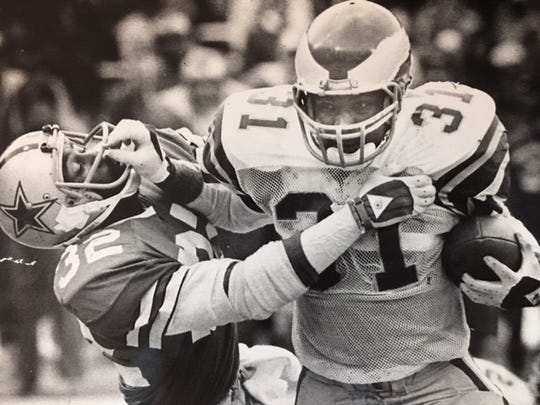 Wilbert Montgomery plows through Cowboys defensive back Dennis Thurman in the NFC Championship game in January of 1981.