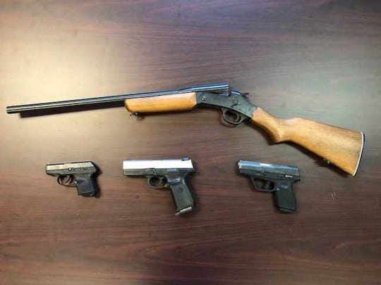 Three handguns and a shotgun were seized when police converged on a York home Friday, arresting two men.