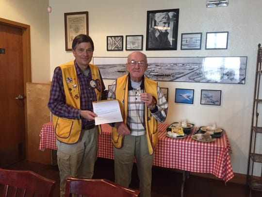 Abilene Founders Lions Club president Jeff Eckard presents