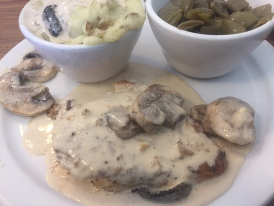 One item on the menu at the Cherry Hill Cafe is the chicken schnitzel jaeger. Two of the available sides are mashed potatoes and green beans.
