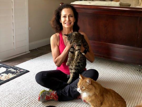 Janice Dimitriou holds Turbo on Tuesday, Jan. 23, 2018,