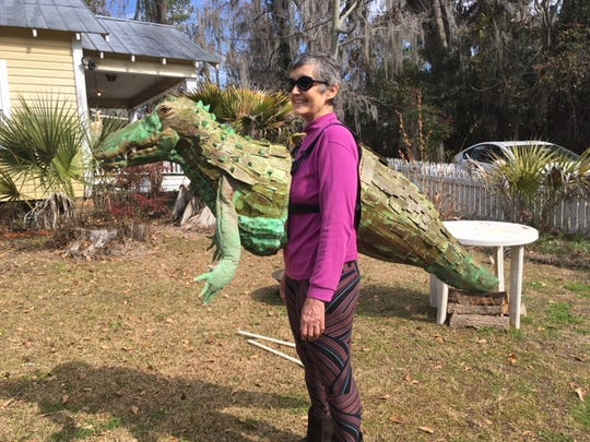 Don't be surprised to see an alligator person strolling around Midtown on Saturday. Artist Linda Hall has created several large critters that are suitable for wearing.