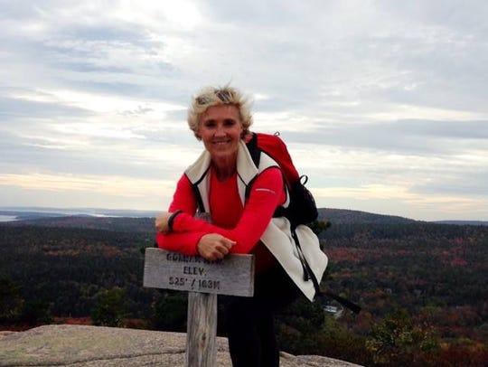 Cindy McConkey Cox after summitting Gorman Mountain in Maine in the fall of 2015.