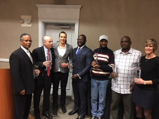 Delaware Basketball Hall of Fame inductees (left to right) Steve Johnson, Mort Kimmel, Kate Mills, Jermaine Medley, Mark Webster (representing his father James), Purnell Ayers and Sarah Cashman.