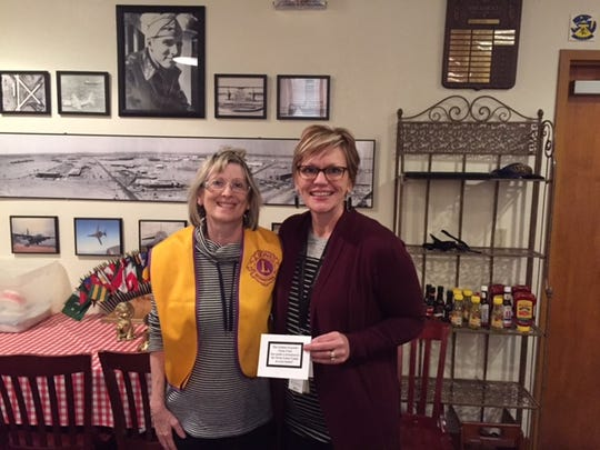 Shara Eckard, of the Abilene Founders Lions Club, meets with Betty Hardwick Center CEO Jenny Goode, who spoke about the center's programs at the club's Jan. 11 meeting. The club made a donation to the Texas Lions Camp on behalf of the center.