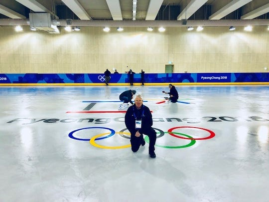 Joe Meierhofer stands on a practice ice surface as it is being painted for the 2018 Winter Olympics in PyeongChang, South Korea.