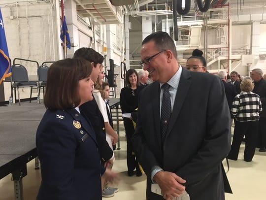 Ontario Mayor Randy Hutchinson talks with Col. Allison