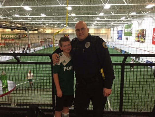 Port Washington Police Officer Gary Belzer hangs out with his son Colton at a youth soccer game. The Port Washington community is rallying to raise money for the medical costs the Belzers have incurred since Belzer was diagnosed with nonalcoholic cirrhosis hepatitis.