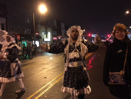 An Eagles-themed Mummer struts down Broad Street after