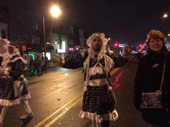 An Eagles-themed Mummer struts down Broad Street after the Super Bowl win.