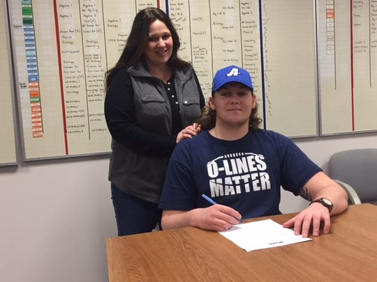 Jon Rioux will attend Assumption College to play football in the Fall. He is accompanied by his mother.