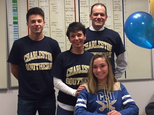 Dakota Fiedler will attend Charleston Southern University in the fall on a women's soccer scholarship. She is pictured with her dad, mom and brother.