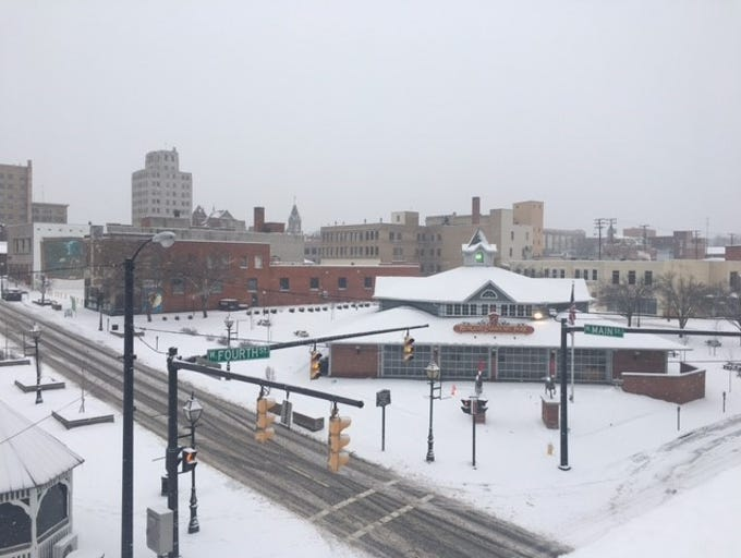 A snowy view from the rooftop of the Coney Island Diner