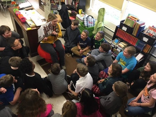 Sarah Shoesmith reads to her classroom at Sterchi Elementary.
