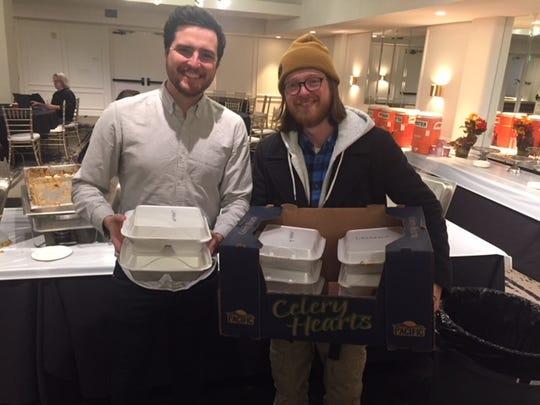 Kieran Thompson and Ryan Cunningham preparing meals