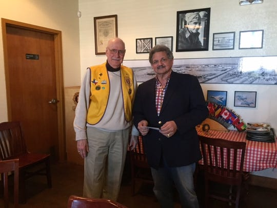 Abilene Founders Lions Club member Jack Darnell meets with Joe Spano, chairman of the Military Affairs Committee, at the club's Feb. 8 meeting. Spano spoke to the club about the committee's efforts to oversee the Dyess Memorial Park project.