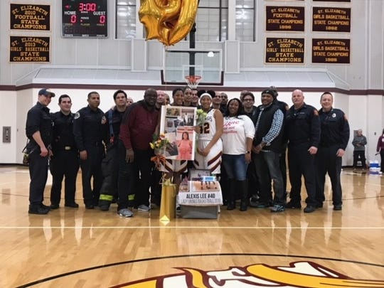About a dozen Wilmington firefighters joined Alexis Lee for her St. Elizabeth basketball Senior Night honors.