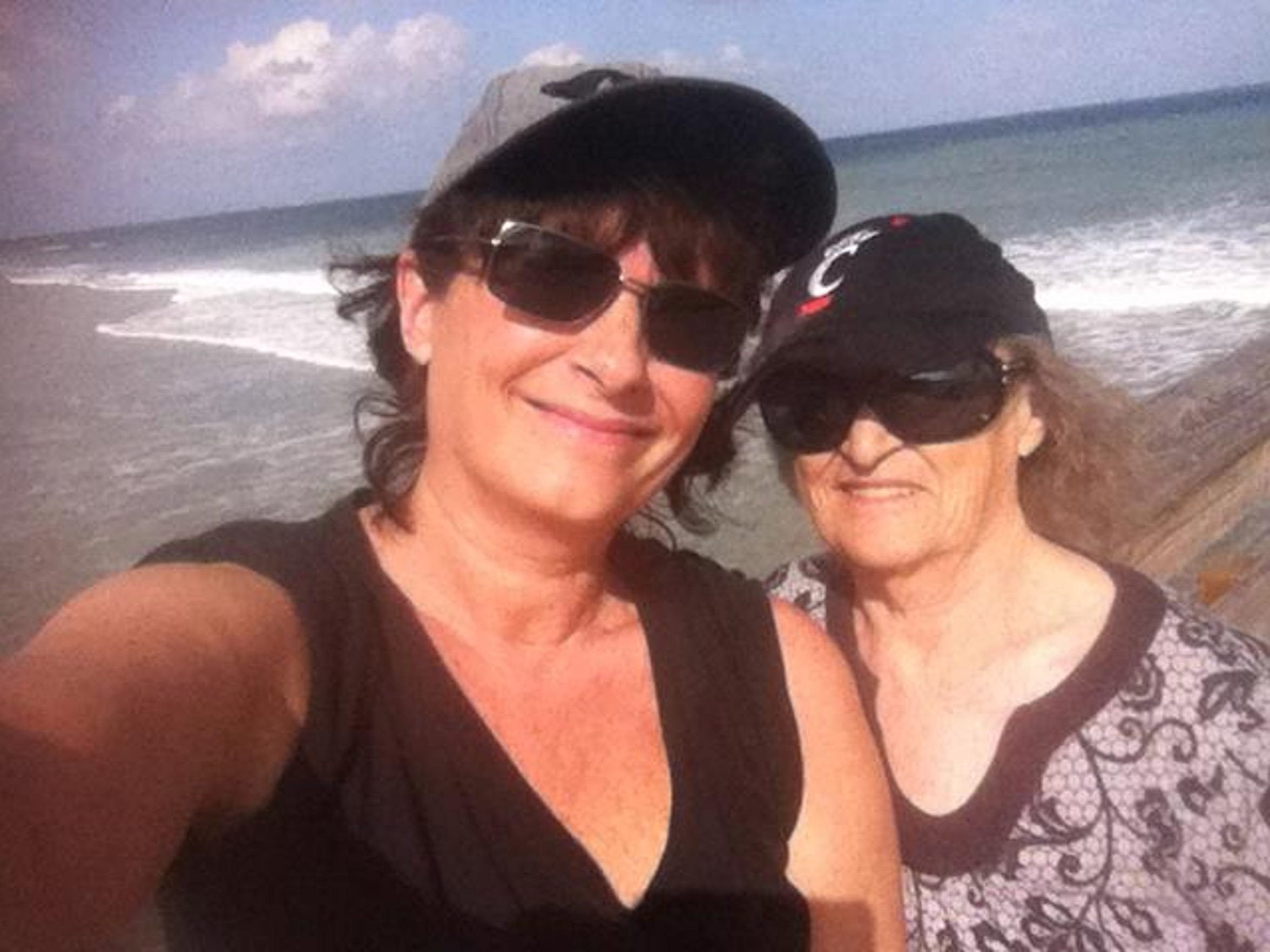Britt Kennerly and her mother, Helen, take a selfie on Cocoa Beach in 2011.