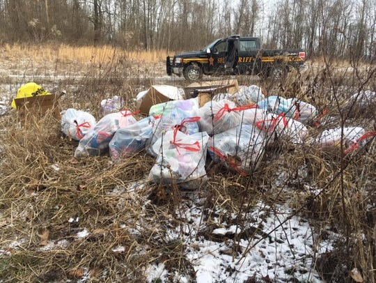 At end of February, Dep. Kevin Cichon, litter prevention officer for the Coshocton County Sheriff's Office, located 27 bags of discarded trash outside Plainfield.