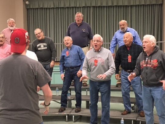 The Fun Center Chordsmen enjoy singing. Here, members