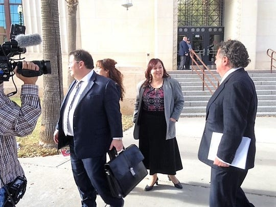 """William """"Billy"""" Abraham, right, his lawyer, Omar Maynez, left, and Judith French, middle, who has done work for Abraham, leave federal bankruptcy court in Downtown El Paso after a hearing Tuesday."""