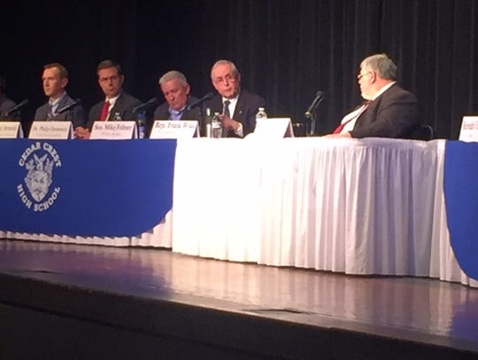 A panel of legislators and local law enforcement addressed