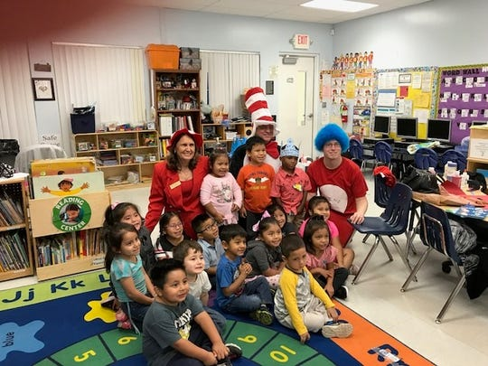 Ruth Pietruszewski, Martin County Tax Collector brought the Cat in the Hat and Thing 1 with her when she visited this Indiantown classroom to read and celebrate Dr. Seuss's birthday.