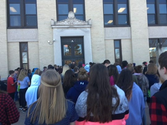 Students gather outside of East Junior High in Wisconsin