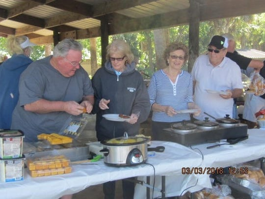 Sandpiper Bay Community  members enjoy their recent cookout.
