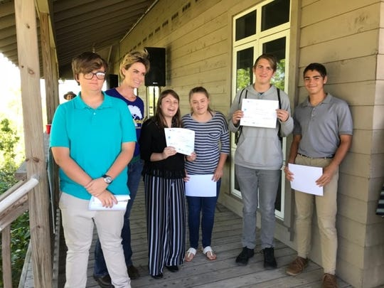 Environmental Learning Center Executive Molly Steinwald, second from left, with Master's Academy students Jake Mason, Sarah Ward, Sarah Davis, Micah Sutter, and Owen Viersma. The students are holding their awards from the Fairchild Challenge.