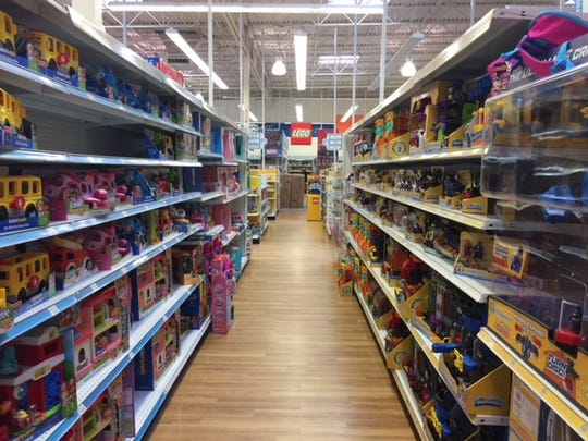 Shelves at the Greenville Toys R Us were well-stocked in advance of an anticipated liquidation sale Thursday. The sale was postponed.
