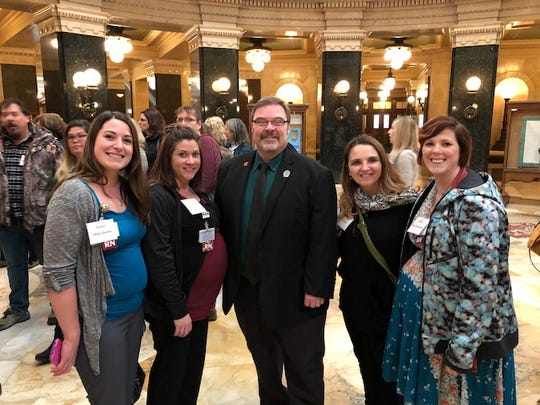 More than 130 Aurora Health Care nurses participated in the Wisconsin Nurses Association (WNA) Day held March 1 in Madison. Left to right: Tiffany Donlon, R.N.; Ashley Ash, R.N.; state Rep. Paul Tittl; Dayna Goetz, R.N.; and Kristi Hasenstein, R.N.