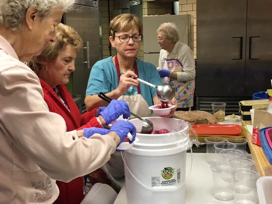 Volunteer Molly Orsini, at right, and volunteers Carol Dropsey, center, and Jean Gurski, left, serve up pickled eggs at the St. Peter's Easter Bake Sale, which continues Wednesday from 7 a.m. to 1 p.m. in the church basement.