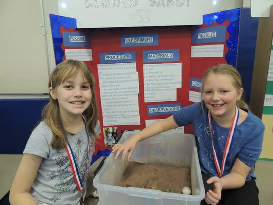 Riverside Elementary School students present their science fair project.