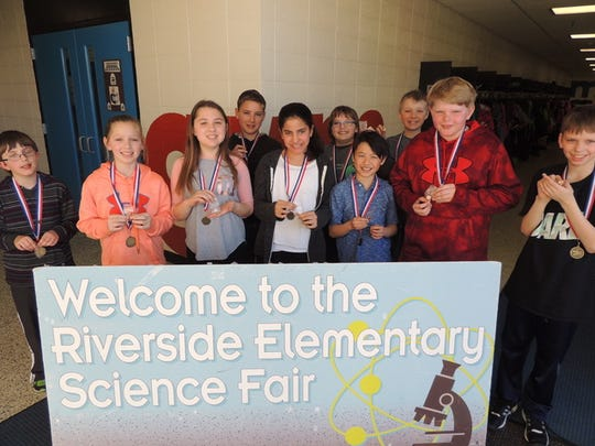 Riverside Elementary School science fair participants show off their medals.