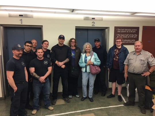 The Gawronksi family enjoys their freedom with the emergency personnel that rescued them from a malfunctioning elevator, March 26, 2018 at Carlsbad Caverns.