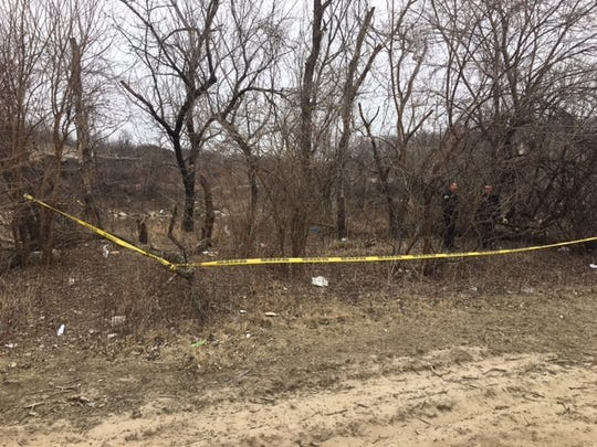 Police tape off the scene where a body was found near