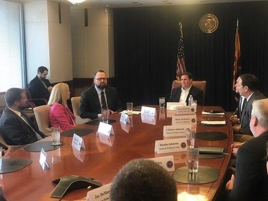 Gov. Doug Ducey meets with members of the medical marijuana