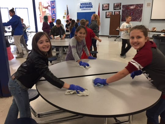 Students at Harpeth Middle School help clean in the