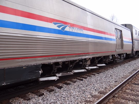 A truck driver was injured Friday when the truck skidded into an Amtrak passenger train carrying 300 people in Dodge County.
