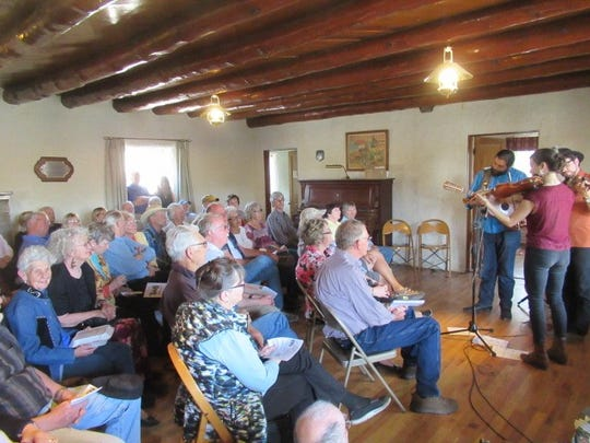 "New Mexico trio, ""Lone Pinon"" consisting of Noah Martinez, Jordan Wax and Leticia Gonzales, performs to a packed house during Carrizozo Music Inc.'s annual fundraising event Sunday."