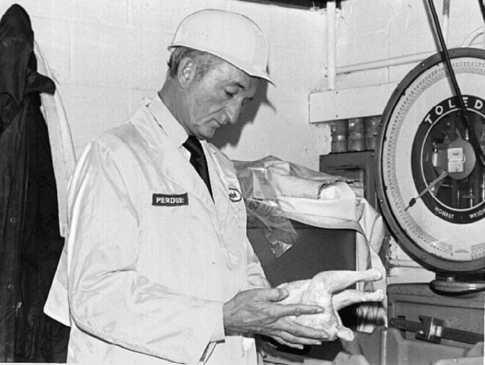 Frank Perdue prepares to weigh a bird at the Salisbury
