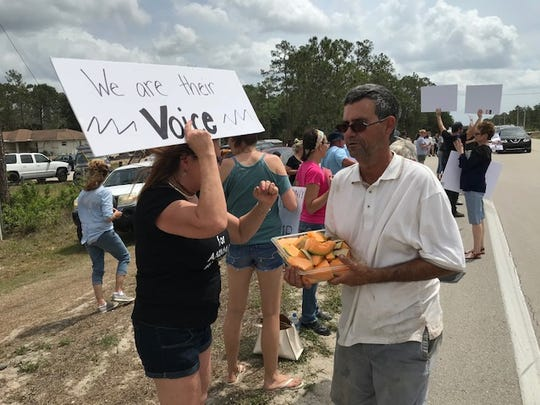 Bob White, who operates a fruit stand along Buckingham Road, passed out fruit to some of the 200 animal rights protestors near his stand in Lehigh Acres in mid-April as part of an organized protest against what they said were alleged illegal slaughterhouse operations in the area.