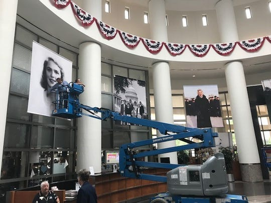 Workers at the George Bush Presidential Library in College Station, Texas, prepare a tribute exhibit to former first lady Barbara Bush on Aprl 18, 2018.