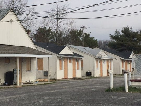 Cabins at the rear of the Pine Rest Motel property in Toms River have been boarded up.