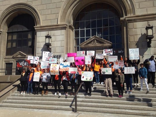 Greendale Schools, Shorewood High School students gather on the courthouse steps in protest of gun violence on the 19th anniversary of the Columbine shooting.