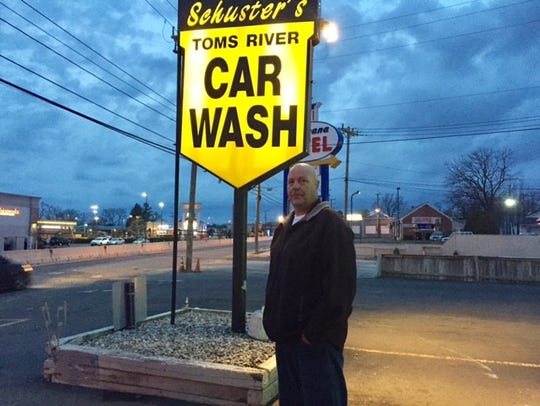 Larry Schuster in front of his Toms River car wash.