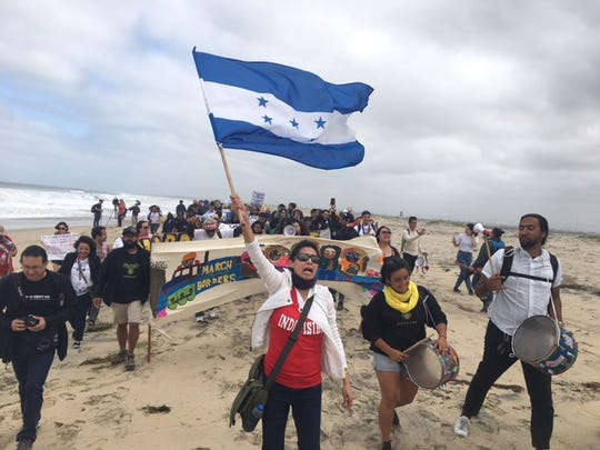 Central American migrants and supporters of the migrant caravan from the U.S. side looking south into Mexico on April 29, 2018.
