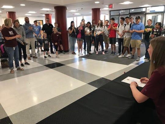 Ankeny resident Emily Larson signs her National Letter